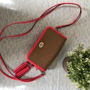 Authentic Coach mini crossbody with tassels